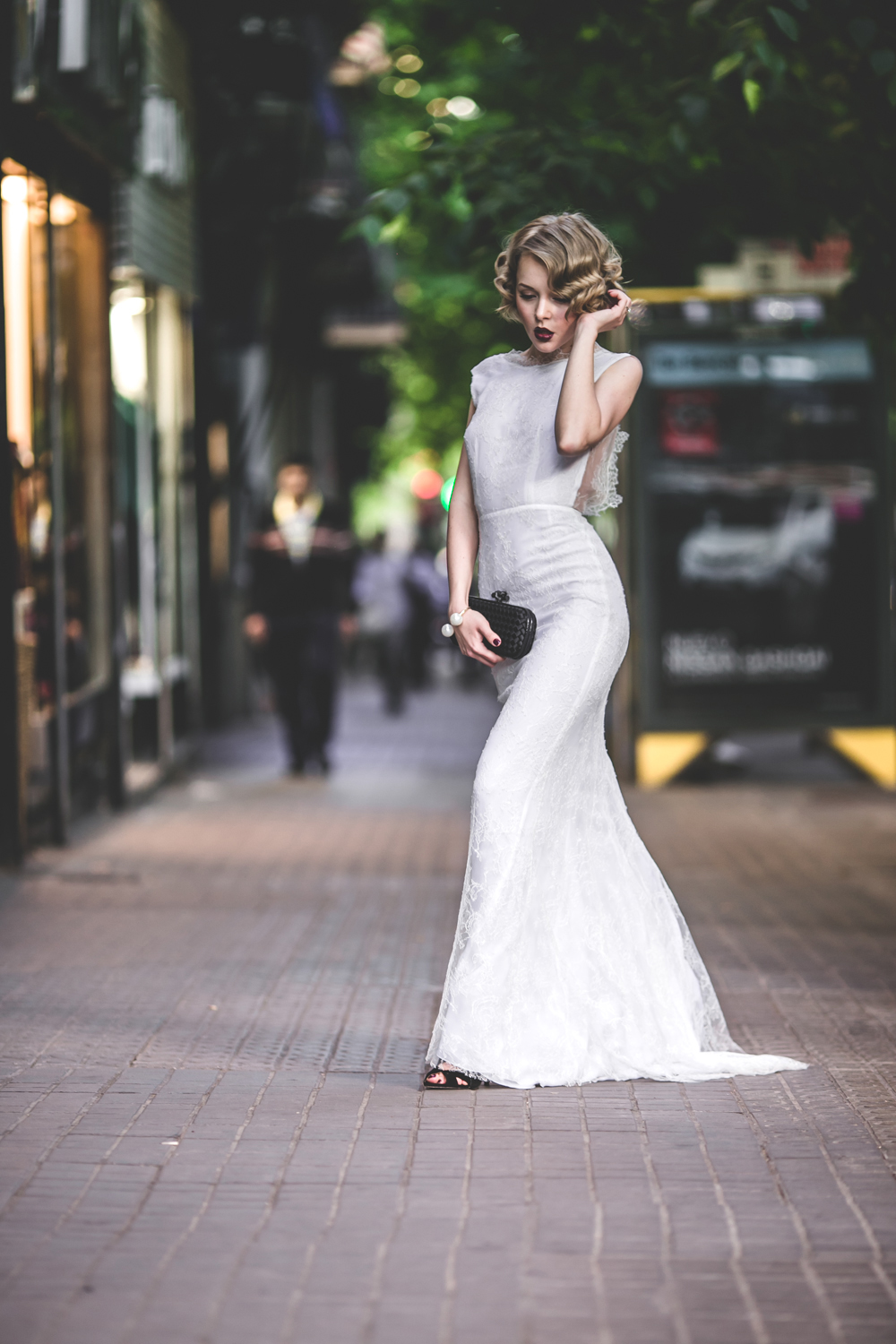 darya kamalova fashion blogger from thecablook in trip in Barcelona Spain with Pronovias 2015 wedding dresses collection catwalk wearing uel camilo white gown bottega veneta knot clutch and black lips-1889
