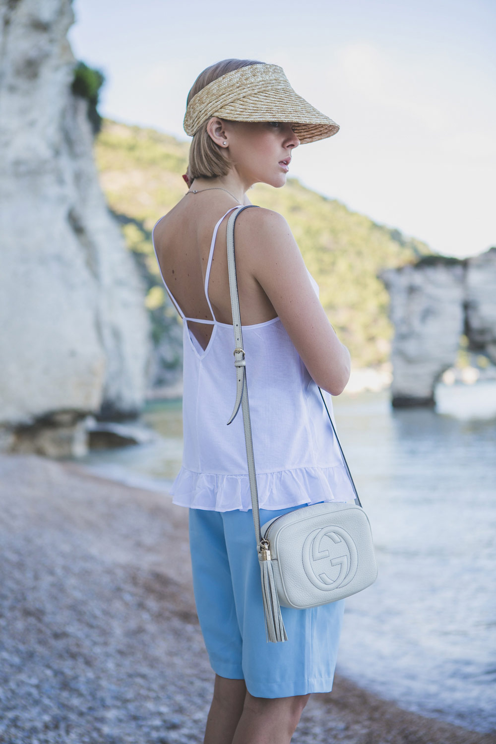 darya-kamalova-thecablook-fashion-lifestyle-blogger-from-thecablook-com-in-puglia-gargano-baia-dei-faraglioni-allegro-italia-in-asos-visor-and-blue-frontrowshop-shorts-with-gucci-disco-soho-bag-1577