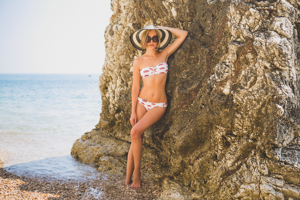 darya kamalova thecablook fashion lifestyle blogger from thecablook com in baia dei faraglioni in puglia south italy wearing river island kisses bikini and straw hat-3274