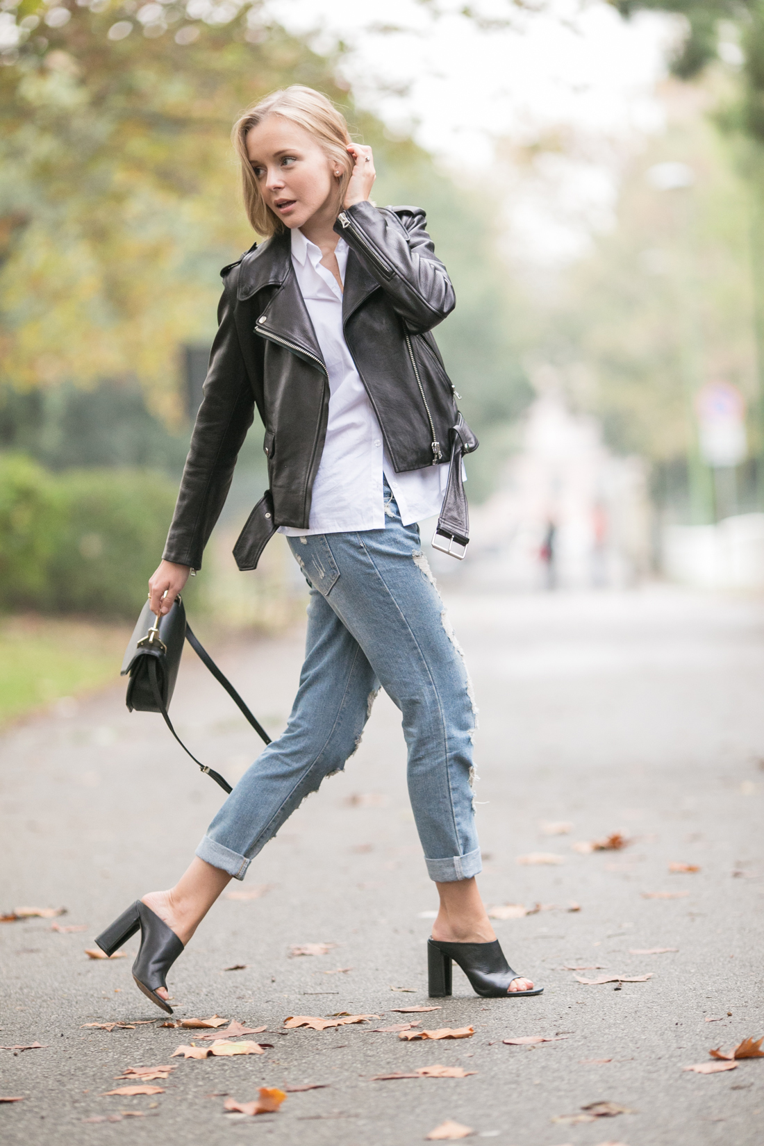 darya kamalova thecablook russian fashion lifestyle blogger in italy outfit spring acne mape leather jacket with boyfriend ripped jeans mules ans m2malletier black bag-24