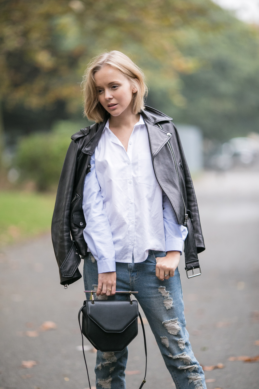 darya kamalova thecablook russian fashion lifestyle blogger in italy outfit spring acne mape leather jacket with boyfriend ripped jeans mules ans m2malletier black bag-5
