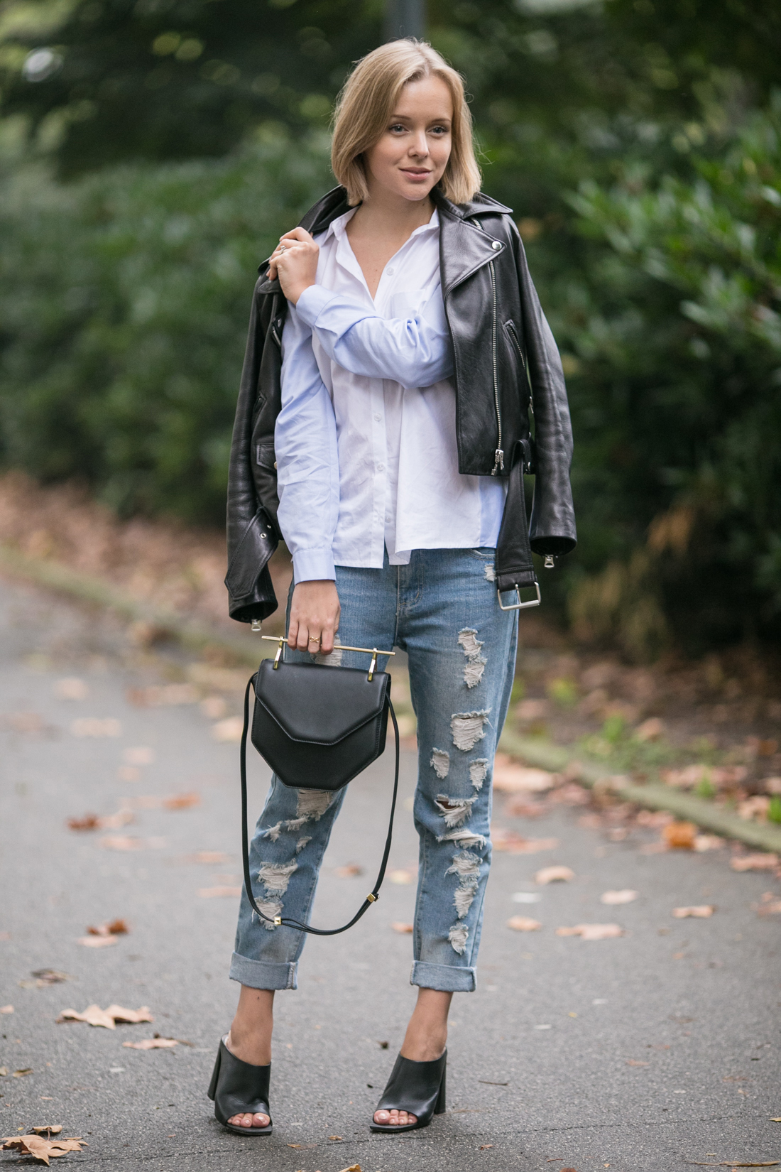 darya kamalova thecablook russian fashion lifestyle blogger in italy outfit spring acne mape leather jacket with boyfriend ripped jeans mules ans m2malletier black bag-7